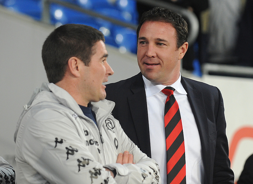 Cardiff City's Manager Malky Mackay chats to Derby's Manager Nigel Clough..Football - npower Football League Championship - Cardiff City v Derby County - Tuesday 05th March 2013 - Cardiff City Stadium - Cardiff..© CameraSport - 43 Linden Ave. Countesthorpe. Leicester. England. LE8 5PG - Tel: +44 (0) 116 277 4147 - admin@camerasport.com - www.camerasport.com