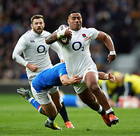 Manu Tuilagi of England takes on the Italy defence. Guinness Six Nations match between England and Italy on March 9, 2019 at Twickenham Stadium in London, England. Photo by: Patrick Khachfe / Onside Images