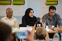 """Pressekonferenz am Montag den 10. Juli 2017 zur Einstellung des Verfahrens gegen Polizisten, welche im September 2016 den irakischen Fluechtling Hussam Fadl Hussein bei einem Polizeieinsatz auf dem Gelaende einer Fluechtlingsunterkunft.<br /> Der 29 jaehrige Familienvater und Polizist wurde am 27.9.2016 in einer Berliner Fluechtlingsunterkunft von drei Polizisten von hinten erschossen, als er versucht haben soll sich einem festgenommenen Mann zu naehern, der seine Tochter missbraucht haben soll. Die Polizei hatte behauptet in Notwehr gehandelt zu haben, da Hussam Fadl Hussein angeblich mit einem Messer bewaffnet gewesen sein soll. Augenzeugen sagten jedoch aus, dass Hussam Fadl Hussein nicht bewaffnet gewesen sei und kein Messer gehabt habe.<br /> Die Staatsanwaltschaft hat das Ermittlungsverfahren Ende Mai 2017 mit dem Verweis auf Notwehr der Beamten eingestellt.<br /> Die Initiativen """"Reach Out"""", """"Kampagne fuer Opfer rassistischer Polizeigewalt (KOP)"""", der Fluechtlingsrat Berlin und Haman Gate (Ehefrau des Erschossenen) fordern die Wiederaufnahme der Emittlungen, eine Anklageerhebung der Staatsanwaltschaft und ein Strafverfahren gegen die Polizeibeamten, die auf Hussam Fadl geschossen haben und die sofortige Suspendierung der beschuldigten Polizisten. Um diese Forderung zu Unterstuetzen wird es am 10. Juli 2017 vor dem Polizeipraesidium geben.<br /> Im Bild vlnr.: Biplab Basu, ReachOut Berlin; Haman Gate, Ehefau des Erschossenen; Dolmetscher.<br /> 10.7.2017, Berlin<br /> Copyright: Christian-Ditsch.de<br /> [Inhaltsveraendernde Manipulation des Fotos nur nach ausdruecklicher Genehmigung des Fotografen. Vereinbarungen ueber Abtretung von Persoenlichkeitsrechten/Model Release der abgebildeten Person/Personen liegen nicht vor. NO MODEL RELEASE! Nur fuer Redaktionelle Zwecke. Don't publish without copyright Christian-Ditsch.de, Veroeffentlichung nur mit Fotografennennung, sowie gegen Honorar, MwSt. und Beleg. Konto: I N G - D i B a, IBAN DE58500105175400192269, BIC I"""