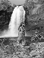 Young Hawaiian girl, Wai'ale Falls on the Wailuku river near Hilo.
