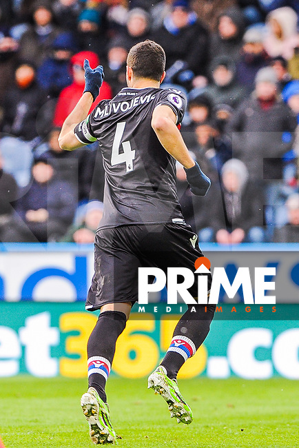 Crystal Palace's midfielder Luka Milivojevic (4) celebrates his penalty during the EPL - Premier League match between Huddersfield Town and Crystal Palace at the John Smith's Stadium, Huddersfield, England on 17 March 2018. Photo by Stephen Buckley / PRiME Media Images.