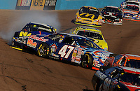 Nov 12, 2005; Phoenix, Ariz, USA;  Nascar Busch Series driver Jon Wood is spun entering turn one during the Arizona 200 at Phoenix International Raceway. Mandatory Credit: Photo By Mark J. Rebilas