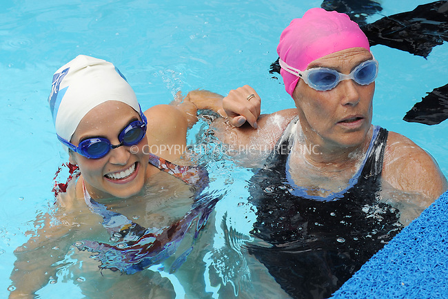 WWW.ACEPIXS.COM<br /> October 9, 2013...New York City<br /> <br /> Nikki Reed and Diana Nyad swim to raise funds for Hurricane Sandy victims in Midtown Manhattan in New York City on October 9, 2013. <br /> <br /> Byline: Kristin Callahan/Ace Pictures<br /> <br /> ACE Pictures, Inc.<br /> tel: 646 769 0430<br />       212 243 8787<br /> e-mail: info@acepixs.com<br /> web: http://www.acepixs.com