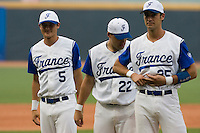 20 August 2007: From left to right, Kenji Hagiwara, Vincent Ferreira and Jerome Rousseau during the players introduction prior to the Czech Republic 6-1 victory over France in the Good Luck Beijing International baseball tournament (olympic test event) at the Wukesong Baseball Field in Beijing, China.