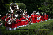 Washington, DC - July 4, 2009 -- The United States Marine Corps Marching Band makes its way into the White House after performing for President Barack Obama and a gathering of military families at the White House on July 4, 2009 in Washington, DC. President Obama is leaving tomorrow on a trip to Russia, Italy, and Ghana..Credit: Brendan Hoffman - Pool via CNP
