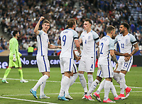 John Stones (left) (Manchester City) of England punches the air during Celebrations as Harry Kane (Tottenham Hotspur) of England equalises at 2 2 during the International Friendly match between France and England at Stade de France, Paris, France on 13 June 2017. Photo by David Horn/PRiME Media Images.