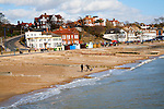Sandy beach and historic buildings on the seafront on a sunny day in winter at Felixstowe, Suffolk, England
