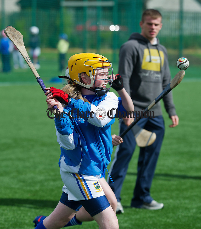 Emma Hall in action under the watchful eye of coach Sean Collins during the camogie and hurling Easter camp at Parteen GAA field. Photograph by John Kelly.