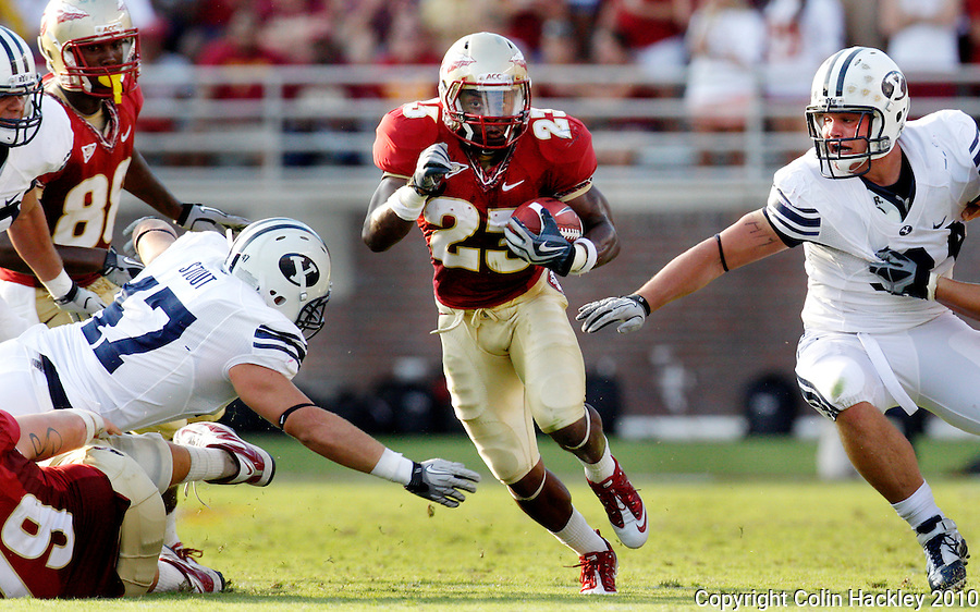 TALLAHASSEE, FL 9/18/10-FSU-BYU FB10 CH-Florida State's Chris Thompson finds running room between Brigham Young defenders during second half action Saturday at Doak Campbell Stadium in Tallahassee. The Seminoles beat the Cougars 34-10..COLIN HACKLEY PHOTO