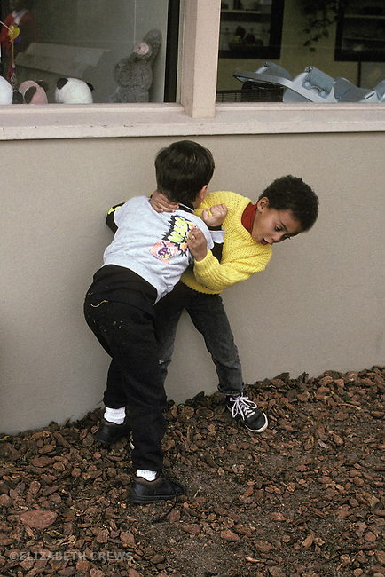 Palo Alto, CA Boys, 4-years-old, in rough and tumble play at preschool