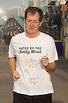 "© Joel Goodman - 07973 332324 . No syndication permitted . 24/09/2013 . Brighton , UK . ALASTAIR CAMPBELL jogs along Brighton seafront this morning (Tuesday 24th September 2013) wearing a t-shirt that reads "" Hated by the Daily Mail "" and signed by himself , Tony Robinson , Charlie Falconer . Day 3 of the 2013 Labour Party Conference in Brighton . Photo credit : Joel Goodman"