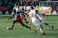 FOXBOROUGH, MA - MARCH 7: Cristian Penilla #70 of New England Revolution breaks free from a tackler during a game between Chicago Fire and New England Revolution at Gillette Stadium on March 7, 2020 in Foxborough, Massachusetts.