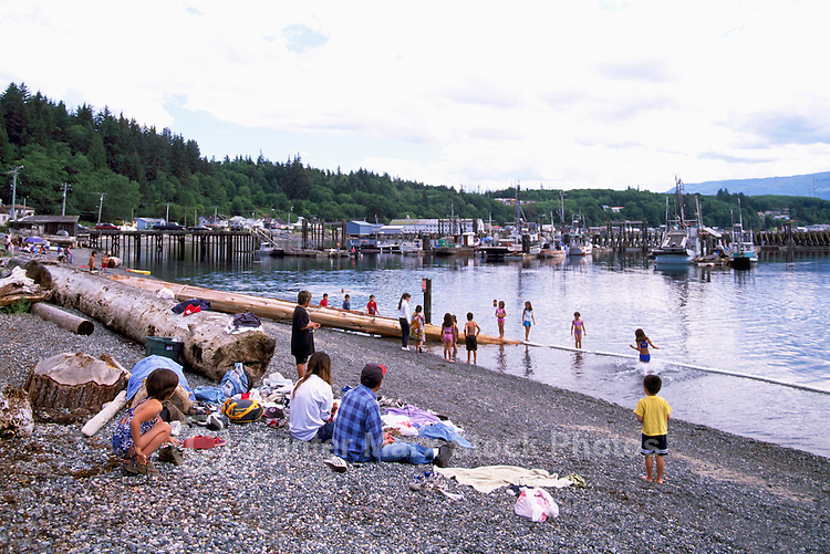 Alert Bay, Cormorant Island, BC, British Columbia, Canada - Native American Indian Children and Families playing and sunbathing on Beach