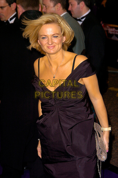 ALICE BEER.British Comedy Awards 2007, London Studios, South Bank, London, England. .December 5th 2007.half length black dress off the shoulder straps silver bag purse .CAP/CAN.©Can Nguyen/Capital Pictures