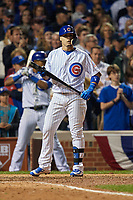 Chicago Cubs Javier Baez (9) bats in the ninth inning during Game 3 of the Major League Baseball World Series against the Cleveland Indians on October 28, 2016 at Wrigley Field in Chicago, Illinois.  (Mike Janes/Four Seam Images)