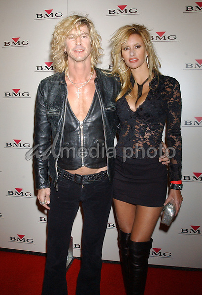 Feb. 8, 2004; Hollywood, CA, USA; Singer DUFF McKAGAN of 'Guns N' Roses' and wife Susan Holmes during the BMG 46th Annual Grammy Awards Post-Grammy Gala Celebration held at The Avalon. Mandatory Credit: Photo by Laura Farr/AdMedia. (©) Copyright 2003 by Laura Farr