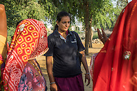 A group of women who are a part of Technoserve's kitchen garden program, gather for a training with a Technoserve personnel in Bamanwali village, Bikaner, Rajasthan, India on October 24th, 2016. Non-profit organisation Technoserve works with guar farmer's wives in Bikaner, providing technical support and training for edible gardening, to improve the nutritional quality of their food and relieve financial stress on farming communities. Photograph by Suzanne Lee for Technoserve