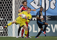 CHESTER, PA - AUGUST 12, 2012:  Zac MacMath (18) of the Philadelphia Union grabs the ball in front of  Arnie Friedrich (23) of the Chicago Fire during an MLS match at PPL Park, in Chester, PA on August 12. Fire won 3-1.