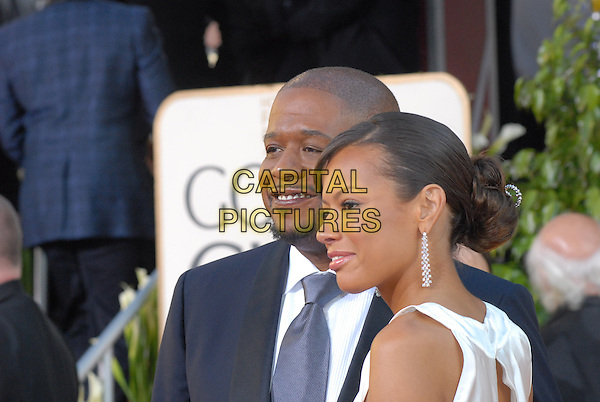 "FOREST WHITAKER & KEISHA WHITAKER.Red Carpet Arrivals - 64th Annual Golden Globe Awards, Beverly Hills HIlton, Beverly Hills, California, USA..January 15th 2007.globes couple married husband wife white blue suit jacket profile earrings.CAP/AW.Please use accompanying story.Supplied by Capital Pictures.© HFPA"" and ""64th Golden Globe Awards"""