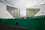 A fan making his way towards the East Stand at Easter Road stadium before the Scottish Championship match between Hibernian and visitors Alloa Athletic. The home team won the game by 3-0, watched by a crowd of 7,774. It was the Edinburgh club's second season in the second tier of Scottish football following their relegation from the Premiership in 2013-14.