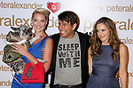 LOS ANGELES, CA. - October 22: Actress Katherine Heigl, designer Peter Alexander and actress Alicia Silverstone arrive at the Peter Alexander Flagship Boutique Grand Opening And Benefit on October 22, 2008 in Los Angeles, California.