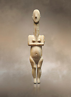 Cycladic statue figurine of the naturalistic 'Plastira' type of Paros from Glypha cemetery, grave 23, Cat no 4762. Early Cycladic Period I (Grotta-Pelos Phase 3200-2800 BC). National Archaeological Museum, Athens. <br /> <br /> This type of Cycladic figurine stand with feet lat to the ground with detailed facial features and ears to make a more realistic statue.
