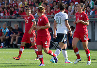02 June 2013: U.S Women's National Soccer Team forward Abby Wambach #20 walks by Canadian National Women's Team forward Christine Sinclair #12 during an International Friendly soccer match between the U.S. Women's National Soccer Team and the Canadian Women's National Soccer Team at BMO Field in Toronto, Ontario.<br /> The U.S. Women's National Team Won 3-0.