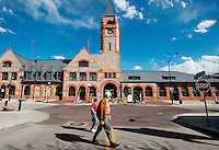 People walk past the newly renovated Union Pacific Railway Station in downtown Cheyenne, Wyoming, Thursday, June 2, 2011. Directly opposite the railroad station on Capital Ave is the State Capital building of Wyoming...Photo by Matt Nager
