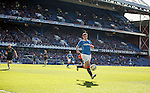 Lee Wallace chasing the ball in the sun