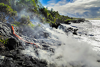 Lava flow ocean entry next to Fox's Landing black sand beach on Hakuma Horst, Lava flow in the trees, Near Hawaii, USA Volcanoes National Park, Kalapana, Hawaii, USA, The Big Island of Hawaii, USA