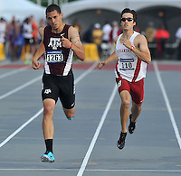 NWA Media/Michael Woods --05/29/2014-- w @NWAMICHAELW...University of Arkansas' Neil Braddy and Texas A&M's Carlyle Roudette cross the finish line in the mens 400 meter preliminaries Thursday afternoon at the 2014 NCAA Division 1 Track and Field West Preliminary track meet at John McDonnell Field in Fayetteville.