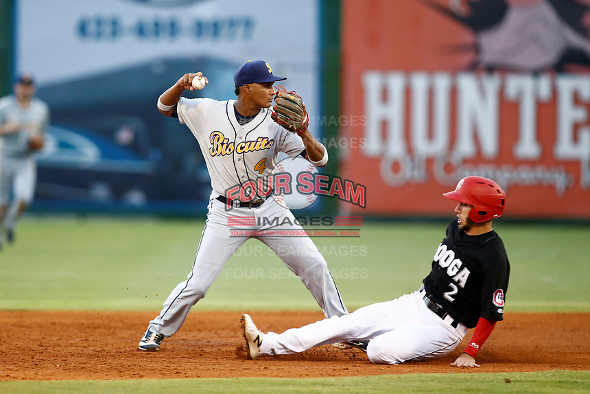 Chattanooga Lookouts Alex Perez (2) is out at second as Montgomery Biscuit short stop Jermaine Palacios (4) turns and throws to first base to compete a double play on May 26, 2018 at AT&T Field in Chattanooga, Tennessee. (Andy Mitchell/Four Seam Images)