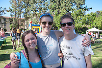 "Ruby Koontz '18, Allison Wendt '18, and Gavin Haffner '16 enjoy Spring Fest 2015 Pre-show activities on Stewie Beach. The event included food trucks, a bounce house, a beer garden, live entertainment from the band ""Dinner"", and more. (Photo by Nick Harrington, Occidental College Class of 2017)"