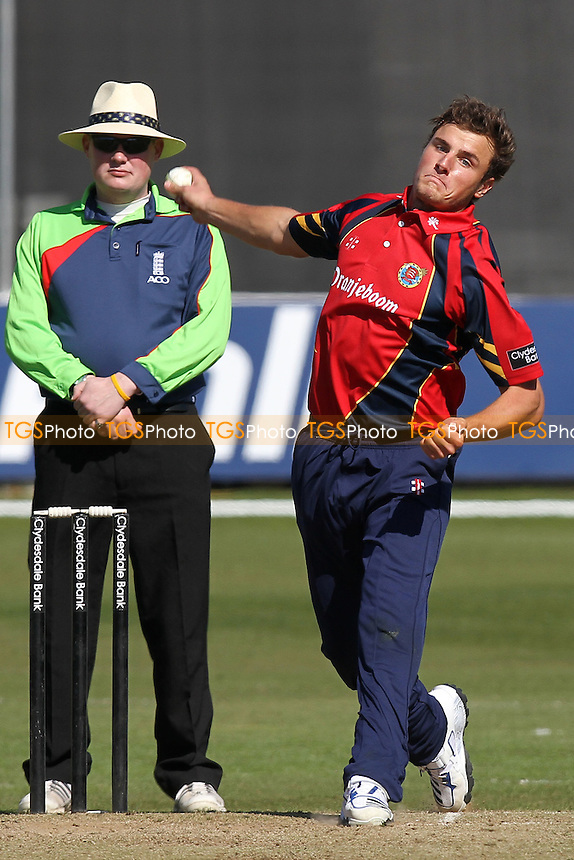 Michael Comber in bowling action for Essex - Essex CCC vs Middlesex CCC - Friendly Cricket Match at the Ford County Ground, Chelmsford, Essex - 26/03/12 - MANDATORY CREDIT: Gavin Ellis/TGSPHOTO - Self billing applies where appropriate - 0845 094 6026 - contact@tgsphoto.co.uk - NO UNPAID USE.