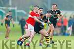 Sean Quilter Austin Stacks in action against  Tom Leo O'Sullivan and Paul Geaney Dingle in the Kerry County Championship Round One between Stacks and Dingle at Pairc an Ághasaigh, Dingle