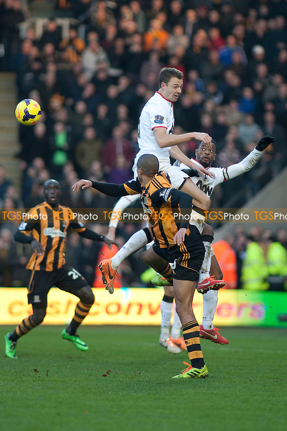 Jonny Evans of Man Utd jumps highest<br />  - Hull City vs Manchester United - Barclays Premier League Football at the KC Stadium, Kingston upon Hull - 26/12/13 - MANDATORY CREDIT: Mark Hodsman/TGSPHOTO - Self billing applies where appropriate - 0845 094 6026 - contact@tgsphoto.co.uk - NO UNPAID USE
