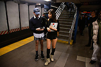NEW YORK - NEW YORK. JANUARY 12: Participants of the No Pants Subway Ride wait the train at the NYC subway system on January 12, 2020 in New York. The annual event, in which participants board a subway car in January while not wearing any pants while behaving as though they do not know each other, began as a joke by the public prank group Improv Everywhere in New York City and has since spread around the world, with enthusiasts in around 60 cities and 29 countries across the globe, according to the organization's site.  (Photo by Pablo Molsalve/VIEWpress)