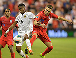 Kevin Galvan (6) of Panama and Tyler Boyd (21) of the United States vie for the ball during their Gold Cup match on June 26, 2019 at Children's Mercy Park in Kansas City, KS.<br /> Tim VIZER/AFP