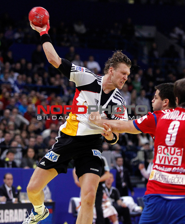 Lars Kaufmann of Germany in action during main round, group 1 men`s EHF EURO 2012 championship handball game between Serbia and Germany in Belgrade, Serbia, Saturday, January 21, 2011.  <br /> Foto &copy; nph /  Pedja Milosavljevic