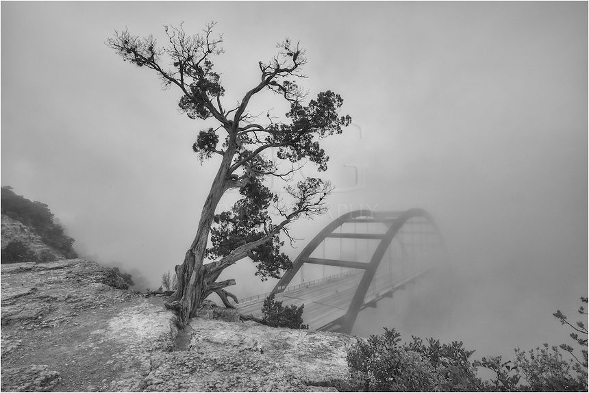 The fog was thick at Pennybacker Bridge on Christmas Eve. I arrived before sunrise, but the sun was nowhere to be found even after sunrise occurred. Normally you can see the Austin skyline in the distance, but it, too, was missing in the fog in this Austin black and white image.