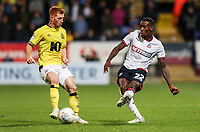 Bolton Wanderers' Lloyd Dyer crosses under pressure from Blackburn Rovers' Harrison Reed<br /> <br /> Photographer Andrew Kearns/CameraSport<br /> <br /> The EFL Sky Bet Championship - Bolton Wanderers v Blackburn Rovers - Saturday 6th October 2018 - University of Bolton Stadium - Bolton<br /> <br /> World Copyright &copy; 2018 CameraSport. All rights reserved. 43 Linden Ave. Countesthorpe. Leicester. England. LE8 5PG - Tel: +44 (0) 116 277 4147 - admin@camerasport.com - www.camerasport.com