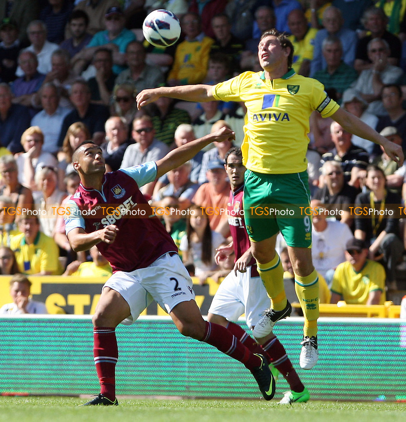 Winston Reid of West Ham and Grant Holt of Norwich - Norwich City vs West Ham United, Barclays Premier League at Carrow Road, Norwich - 15/09/12 - MANDATORY CREDIT: Rob Newell/TGSPHOTO - Self billing applies where appropriate - 0845 094 6026 - contact@tgsphoto.co.uk - NO UNPAID USE.