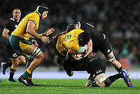 Isi Naisarani (Wallabies) is tackled by Matt Todd and Kieran Read during the Bledisloe Cup rugby match between the New Zealand All Blacks and Australia Wallabies at Eden Park in Auckland, New Zealand on Saturday, 17 August 2019. Photo: Simon Watts / lintottphoto.co.nz