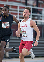 NWA Democrat-Gazette/BEN GOFF @NWABENGOFF<br /> Kristoffer Hari of Arkansas runs the men's 100 meter dash Friday, April 12, 2019, at the John McDonnell Invitational at John McDonnell field in Fayetteville. Hari won with a time of 10.31 seconds.