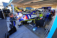 Nov. 9, 2008; Avondale, AZ, USA; The car of NASCAR Sprint Cup Series driver Jimmie Johnson is worked on in the garage prior to the Checker Auto Parts 500 at Phoenix International Raceway. Mandatory Credit: Mark J. Rebilas-