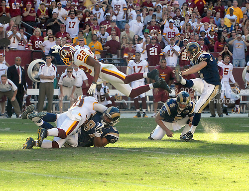 Landover, MD - October 12, 2008 --  Washington Redskins cornerback Carlos Rogers (22) goes airborne to try to block St. Louis Rams kicker Josh Brown's (3) field goal on the last play of the game at FedEx Field in Landover, Maryland on Sunday, October 12, 2008.  The Rams won the game 19 - 17..Credit: Ron Sachs / CNP