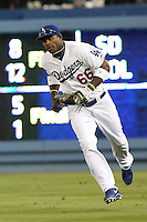 06/06/13 Los Angeles, CA:  Los Angeles Dodgers right fielder Yasiel Puig #66 during an MLB game played between the Los Angeles Dodgers and the Atlanta Braves at Dodger Stadium. The Dodgers defeated the Braves 5-0.