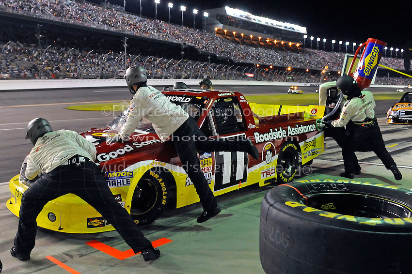 Todd Bodine (#11) makes a pit stop.