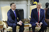US President Donald J. Trump (R) with Polish President Andrzej Duda (L) during a meeting in the Oval Office of the White House in Washington, DC, USA, 12 June 2019. Later in the day President Trump and President Duda will participate in a signing ceremony to increase military to military cooperation including the purchase of F-35 fighter jets and an increased US troop presence in Poland. <br /> Credit: Shawn Thew / Pool via CNP