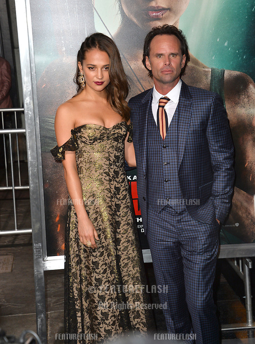 Alicia Vikander &amp; Walton Goggins at the US premiere for &quot;Tomb Raider&quot; at the TCL Chinese Theatre, Los Angeles, USA 12 March 2018<br /> Picture: Paul Smith/Featureflash/SilverHub 0208 004 5359 sales@silverhubmedia.com